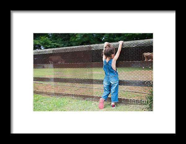 Play Framed Print featuring the photograph Girl Playing Wearing Overalls by Purino
