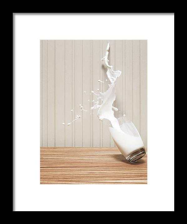 Milk Framed Print featuring the photograph Glas Of Milk Spilling by Henrik Sorensen