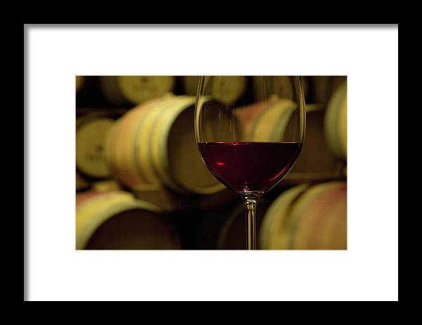 Stellenbosch Framed Print featuring the photograph Glass Of Red Wine In Wine Cellar by Siegfried Layda