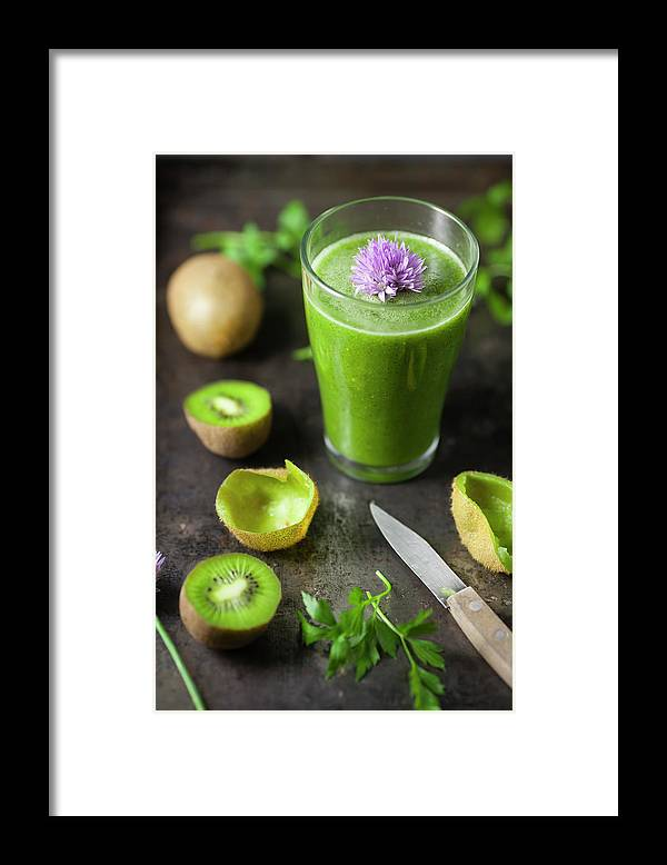 Cutting Board Framed Print featuring the photograph Glass Of Smoothie With Kiwi, Parsley by Westend61