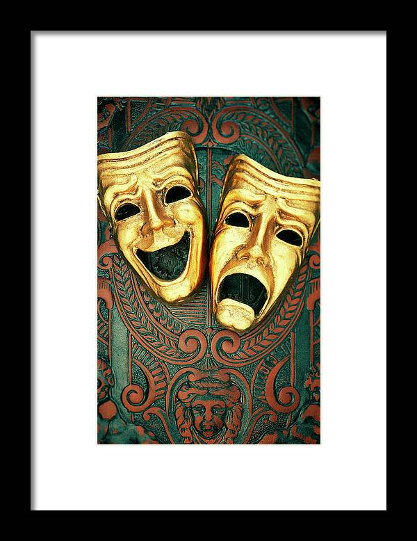 Leather Framed Print featuring the photograph Golden Comedy And Tragedy Masks On by David Muir