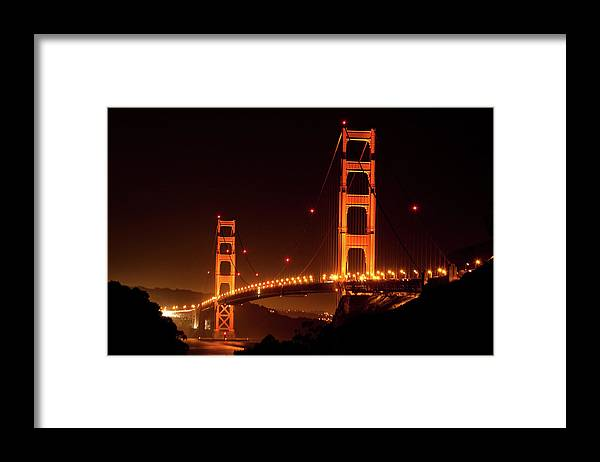 Scenics Framed Print featuring the photograph Golden Gate Bridge At Night by Imaginegolf