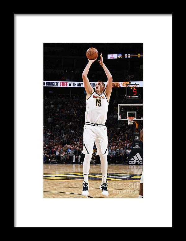 Nba Pro Basketball Framed Print featuring the photograph Golden State Warriors V Denver Nuggets by Garrett Ellwood