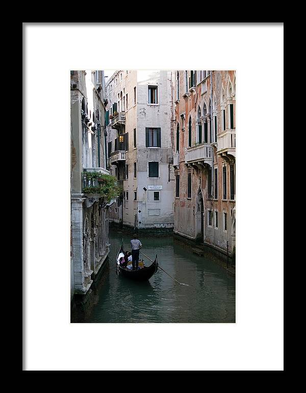 People Framed Print featuring the photograph Gondolier Ferrying People Through Canal by Photodisc
