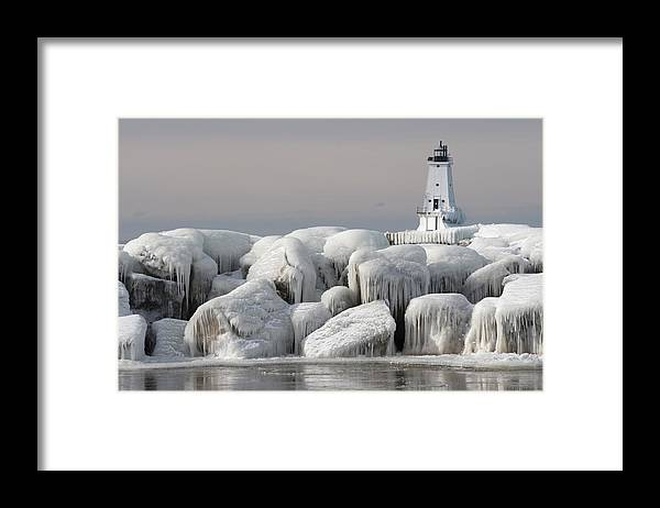 Water's Edge Framed Print featuring the photograph Great Lakes Lighthouse With Ice Covered by Jskiba