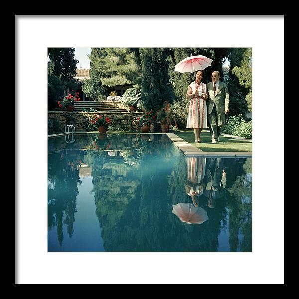 Heterosexual Couple Framed Print featuring the photograph Greek Garden by Slim Aarons