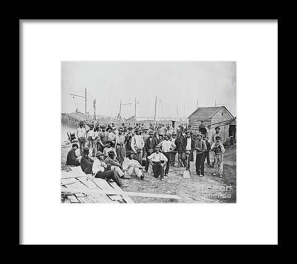 American Civil War Framed Print featuring the photograph Group Of Freed Slaves Along Harbor by Bettmann