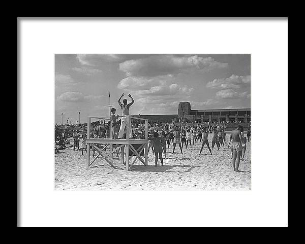 Human Arm Framed Print featuring the photograph Group Of People Exercising On Beach, B&w by George Marks