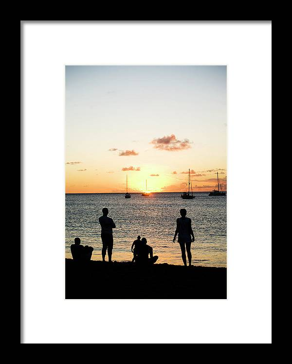 Recreational Pursuit Framed Print featuring the photograph Group Of Young Friends On Beach At by Jaminwell