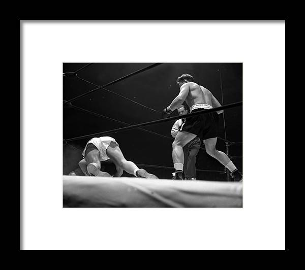 Heavyweight Framed Print featuring the photograph Gus Lesnevitch Vs Melio Bettina by New York Daily News