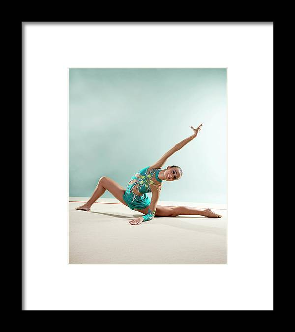 Human Arm Framed Print featuring the photograph Gymnast, Smiling, Bending Backwards by Emma Innocenti