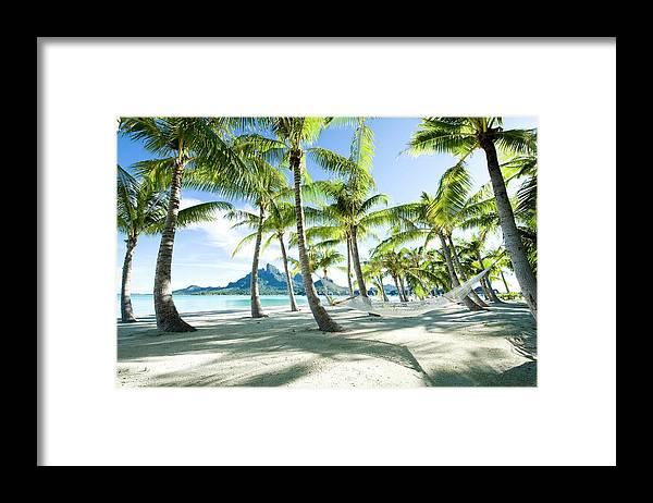 Hanging Framed Print featuring the photograph Hammock At Bora Bora, Tahiti by Yusuke Okada/amanaimagesrf