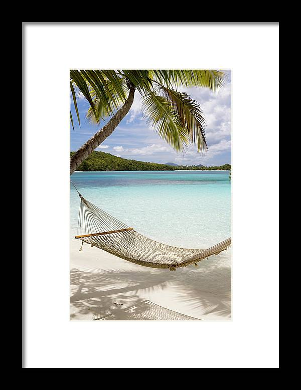 Water's Edge Framed Print featuring the photograph Hammock Hung On Palm Trees On A by Cdwheatley