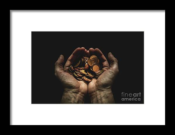 Coin Framed Print featuring the photograph Hands Holding Coins Against Black by Andy Kirby