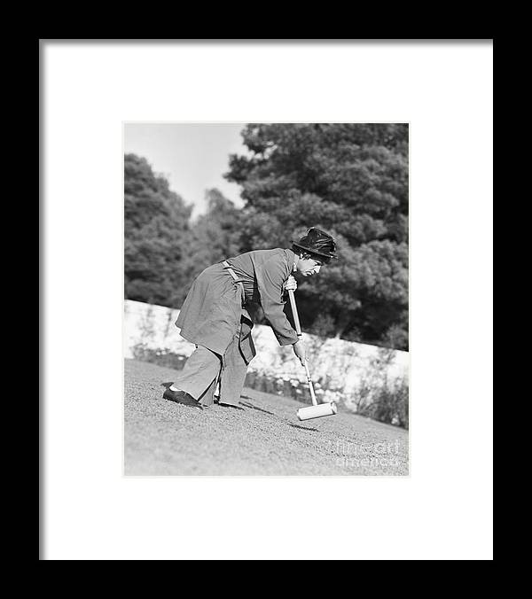 People Framed Print featuring the photograph Harpo Marx Playing Croquet by Bettmann