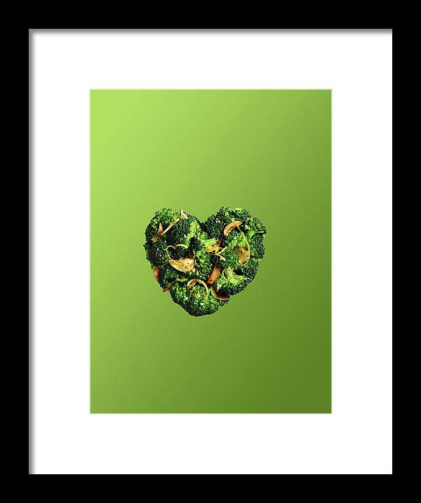 Broccoli Framed Print featuring the photograph Heart Shaped Broccoli On Green by Maren Caruso