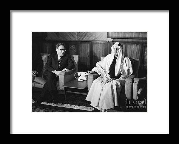 People Framed Print featuring the photograph Henry Kissinger With King Faisal by Bettmann