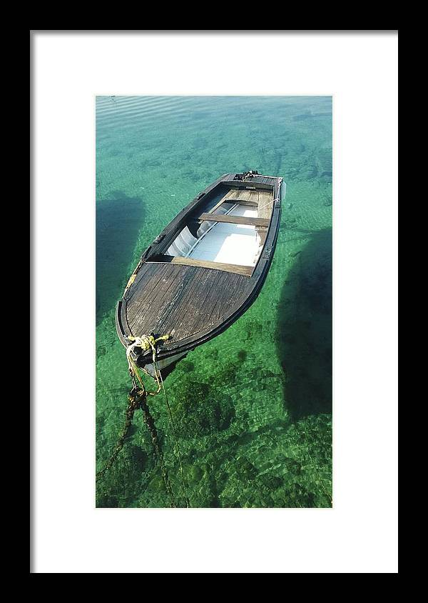 Tranquility Framed Print featuring the photograph High Angle View Of Boat Moored On Sea by Iva Saric / Eyeem