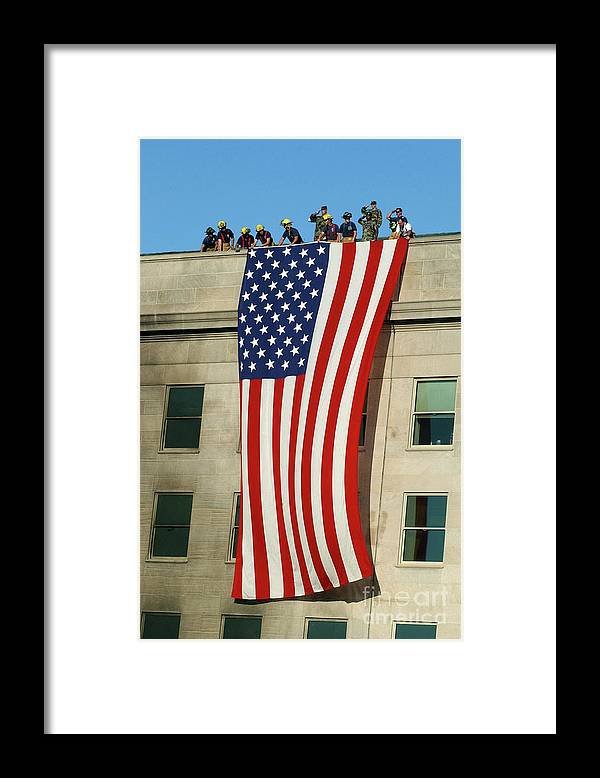 Following Framed Print featuring the photograph Hijacked Plane Slams Into Pentagon by U.s. Navy