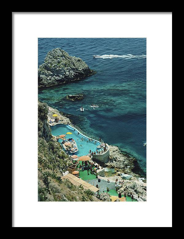 People Framed Print featuring the photograph Hotel Taormina Pool by Slim Aarons