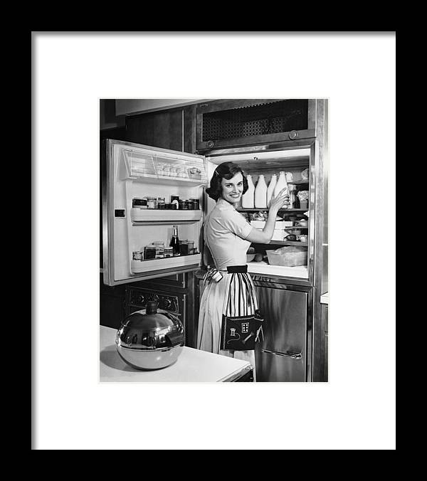 Milk Framed Print featuring the photograph House Wife Removing Milk From by George Marks