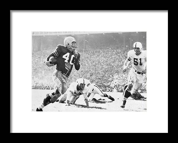 American Football Uniform Framed Print featuring the photograph Howard Cassady Running With Football by Bettmann