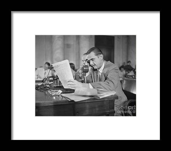 Howard Hughes Framed Print featuring the photograph Howard Hughes Testifying During Senate by Bettmann