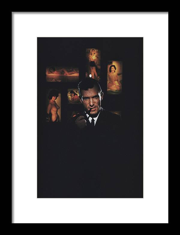 Hugh Hefner Framed Print featuring the photograph Hugh Hefner by Slim Aarons