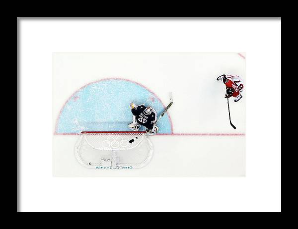 Ryan Miller Framed Print featuring the photograph Ice Hockey - Mens Gold Medal Game - Day by Bruce Bennett