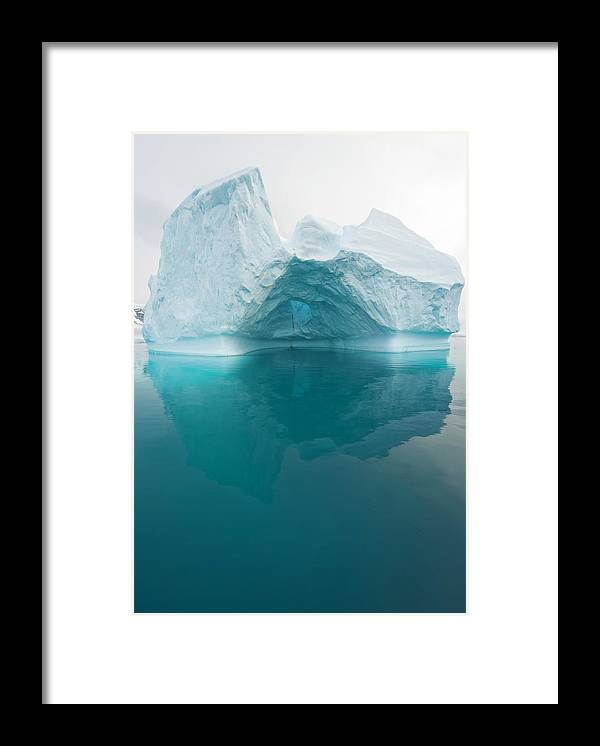 Iceberg Framed Print featuring the photograph Iceberg And Reflections, Antarctic by Eastcott Momatiuk