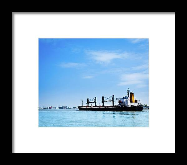 Freight Transportation Framed Print featuring the photograph Industrial Ship On Mississippi River by Lightkey
