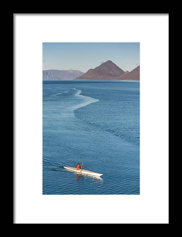 People Framed Print featuring the photograph Inuit Man Paddling Traditionally Shaped by Andrew Peacock