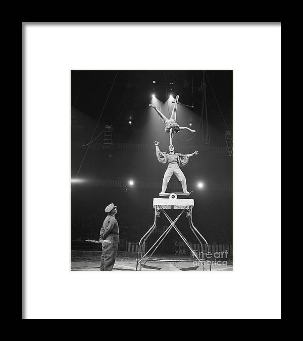 Mid Adult Women Framed Print featuring the photograph Italian Circus Performers Balancing by Bettmann