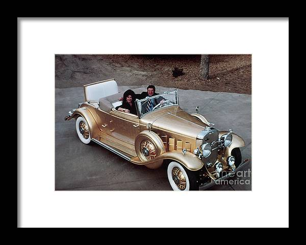 Mid Adult Women Framed Print featuring the photograph Jack Smith In Gold Plated 1931 Cadillac by Bettmann