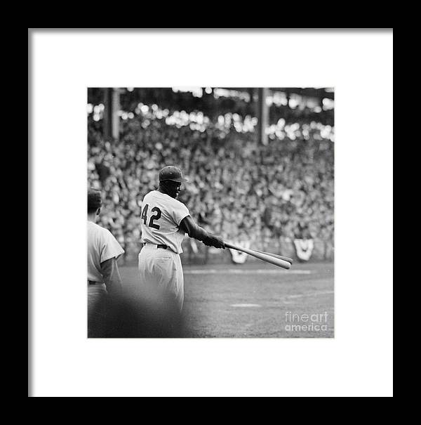 Sports Helmet Framed Print featuring the photograph Jackie Robinson At 1955 World Series by Robert Riger