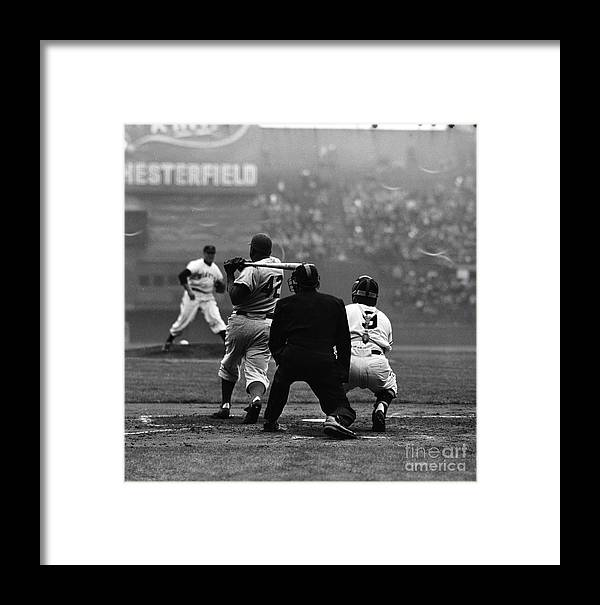 Sports Helmet Framed Print featuring the photograph Jackie Robinson At Bat Against Pitcher by Robert Riger