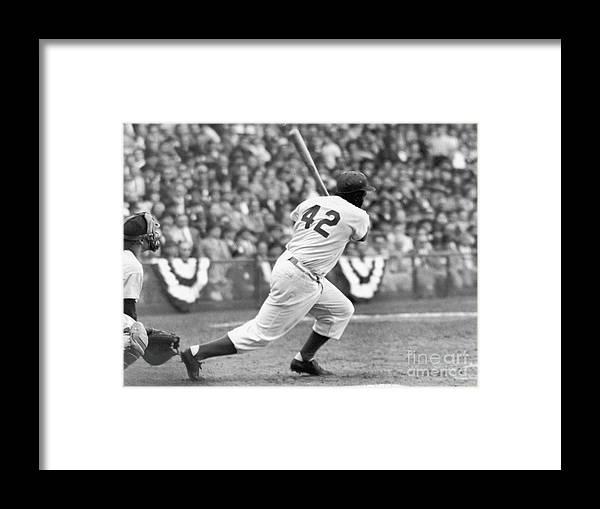 Sports Helmet Framed Print featuring the photograph Jackie Robinson At Bat by Robert Riger