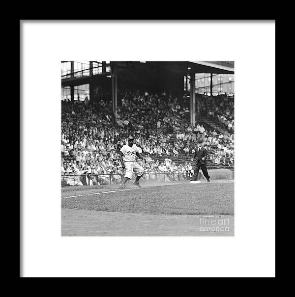 1950-1959 Framed Print featuring the photograph Jackie Robinson At Ebbets Field, 1956 by Robert Riger