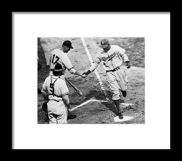 First Baseman Framed Print featuring the photograph Jackie Robinson At Home Plate, 1947 by Bettmann