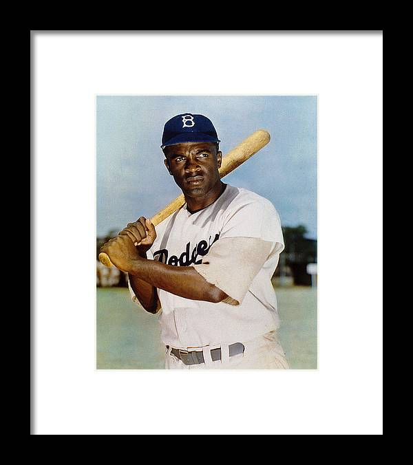 Jackie Robinson Framed Print featuring the photograph Jackie Robinson In Brooklyn Dodgers by New York Daily News Archive