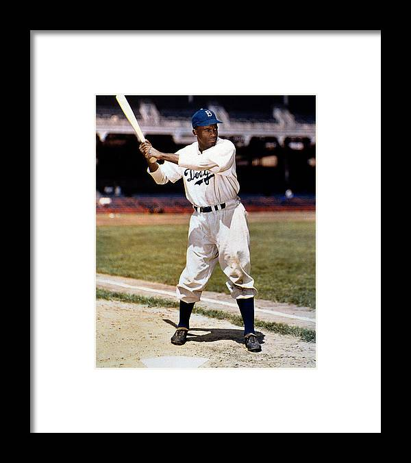 Jackie Robinson Framed Print featuring the photograph Jackie Robinson Of The Brooklyn Dodgers by New York Daily News Archive