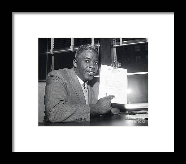 People Framed Print featuring the photograph Jackie Robinson Retires 1957 by Transcendental Graphics