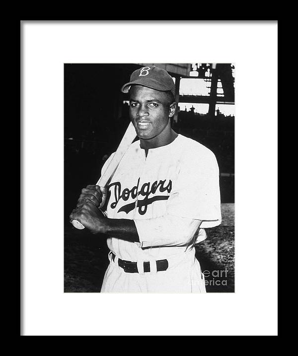 People Framed Print featuring the photograph Jackie Robinson Rookie Dodgers Portrait by Transcendental Graphics