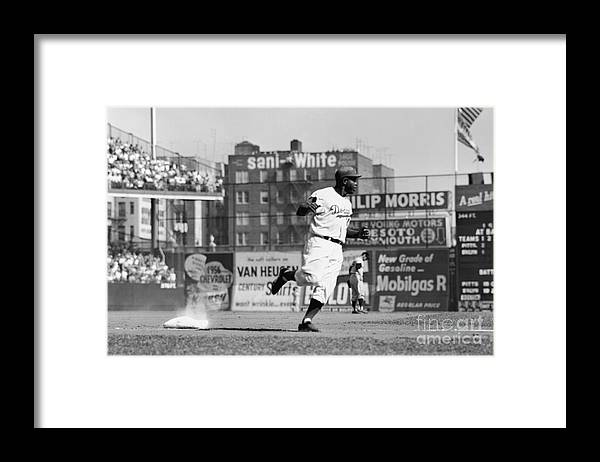 1950-1959 Framed Print featuring the photograph Jackie Robinson Rounds The Bases by Robert Riger