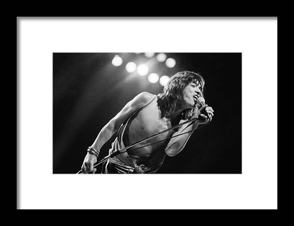 Mick Jagger Framed Print featuring the photograph Jagger At Knebworth by Graham Wood