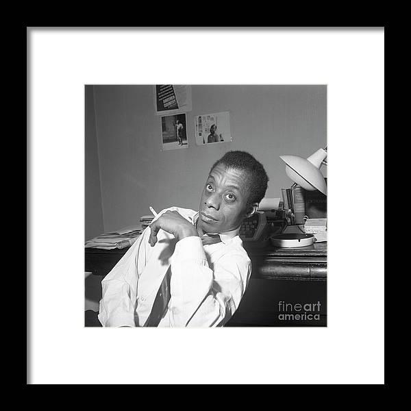 Smoking Framed Print featuring the photograph James Baldwin Sitting Smoking by Bettmann