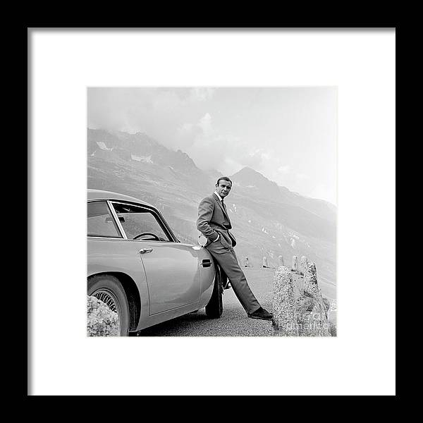 James Bond Framed Print featuring the photograph James Bond Coolly Leaning on His Aston Martin by Doc Braham