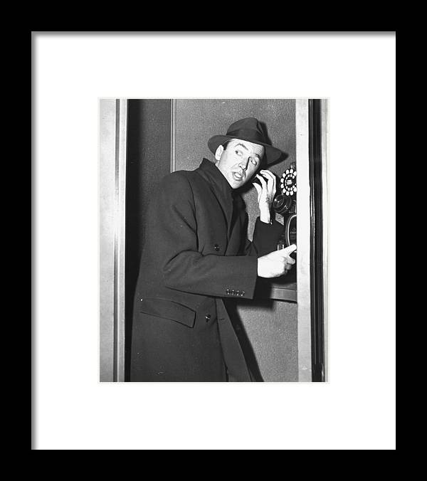 Jimmy Stewart Framed Print featuring the photograph James Stewart Stops To Make A Call At by New York Daily News Archive
