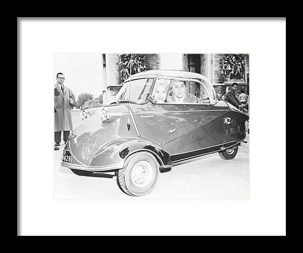 People Framed Print featuring the photograph Janet Leigh And Tony Curtis In Minicar by Bettmann