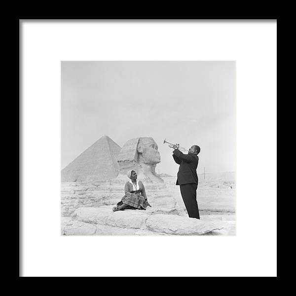 People Framed Print featuring the photograph Jazz Trumpeter Louis Armstrong Playing by Bettmann